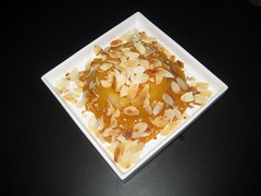 Semolina pudding with apricot sauce and almonds