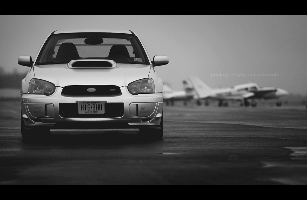 Subaru WRX STi with airplanes