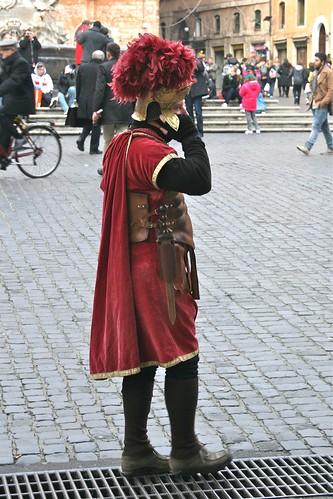 Roman gladiator-type man - on the phone