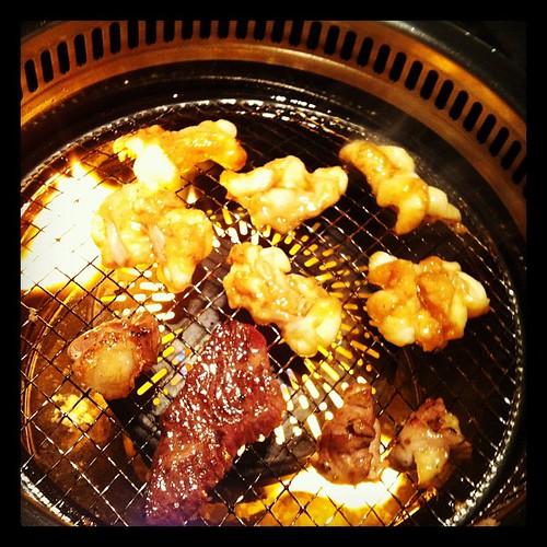 Yakiniku in Japan. Cooking chicken innards