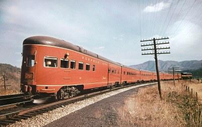 Norfolk & Western Powhatan Arrow streamlined observation car # 581, is seen with it's train near Singer, Virginia 8-12-1949