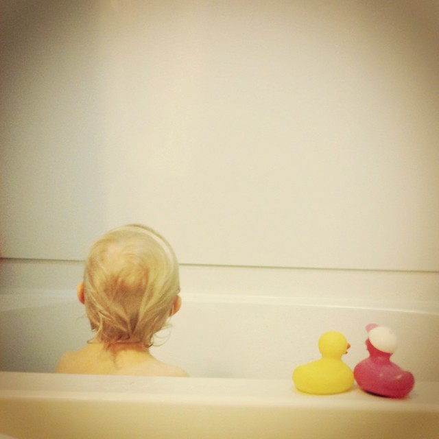 In the tub with ducks