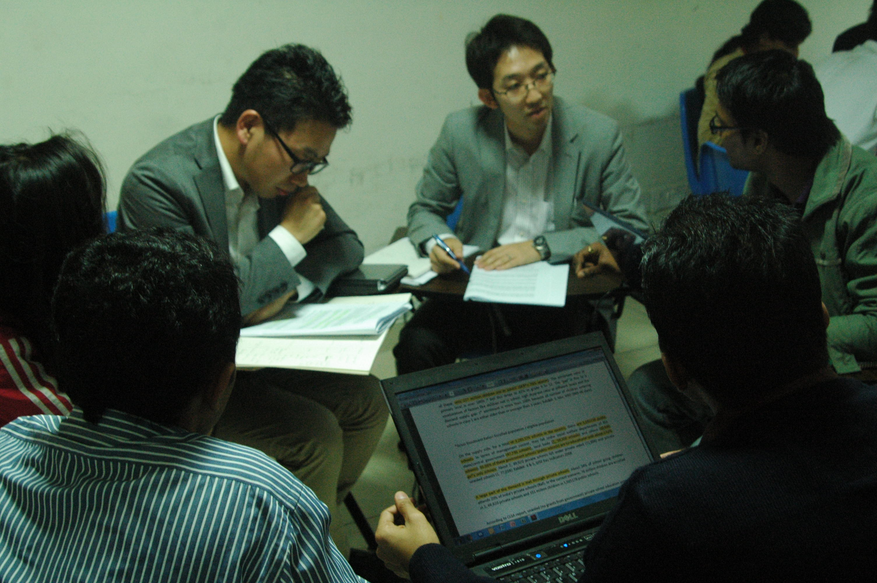 Hitachi executives with IWSB students in a classroom discussion