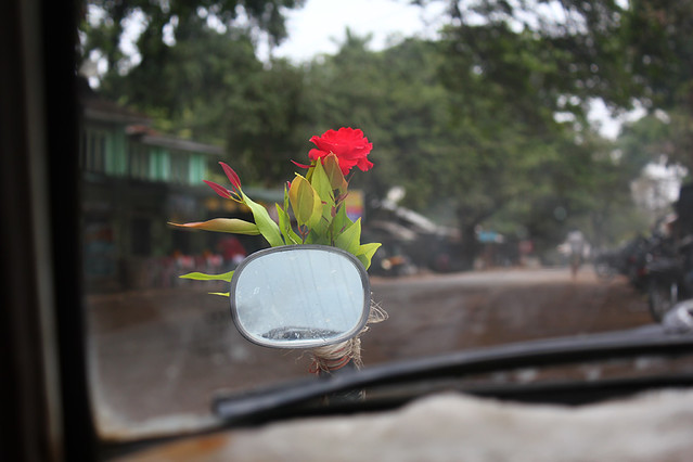 Lucky flowers tying to the front mirrors of our taxi