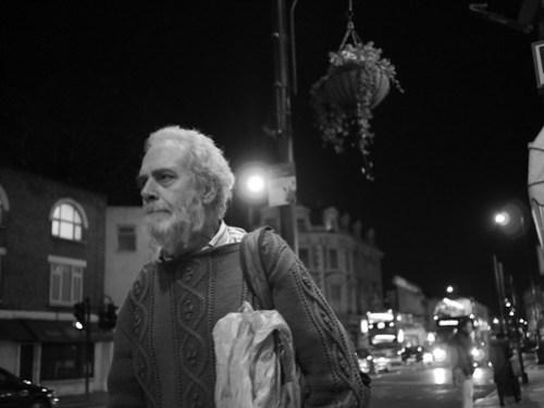 An elderly man with white hair