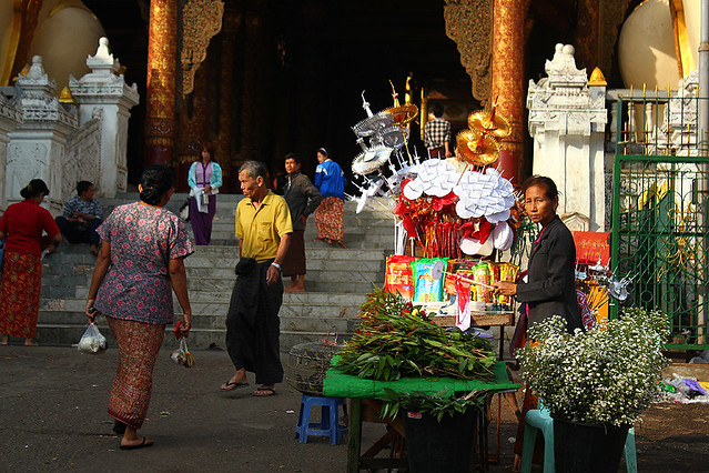 People entering and leaving the East Gate of Swedagon Pagoda