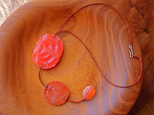 ancient carved carnelian on string by denise carbonell