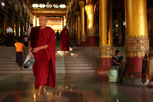 Local people always carry a clear plastic bag for their shoes/sandals/flip-flops.You have to take them off before entering a temple/pagoda in Myanmar