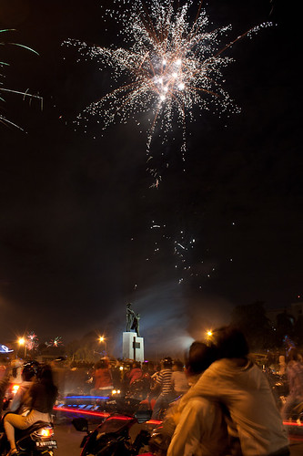 Couple on motorbike admiring fireworks