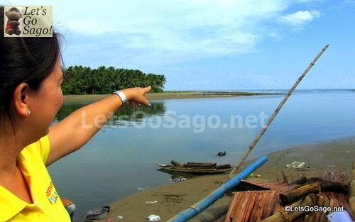 DOT Officer Pointing to a Northern Samar Secret Surfing Spot