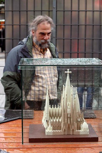 Onlooker observes minimalist model of  Sagrada Família, Barcelona, Spain