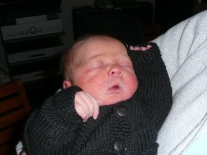 Rave baby! (Leon with his hands in the air, aged 1 day)