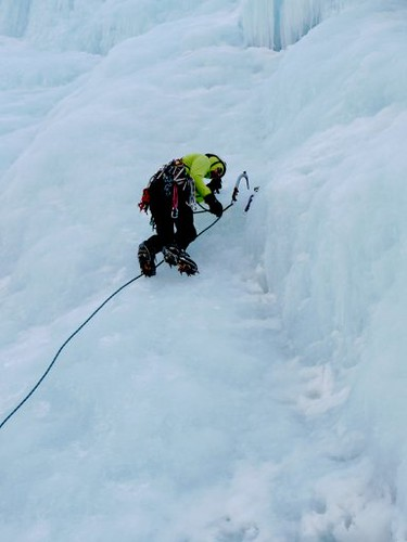 Doug Clipping Into First Screw While Ice Climbing