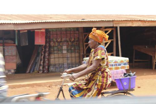Iheaka Village Bicyclist Grandmother by Jujufilms