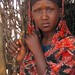 A young woman waits to receive UK-funded food aid in Dolow, Somalia, 28 January 2012
