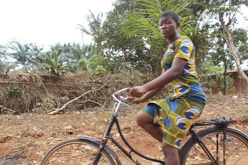Iheaka Village Female Bicyclist by Jujufilms