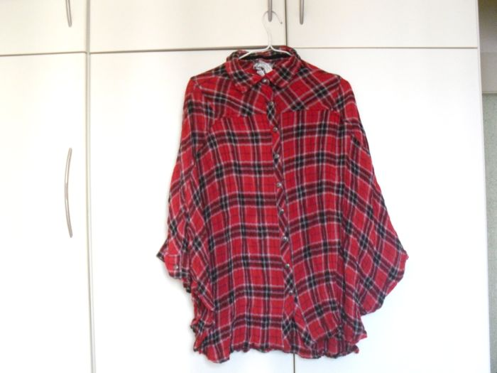 cape-checked blouse