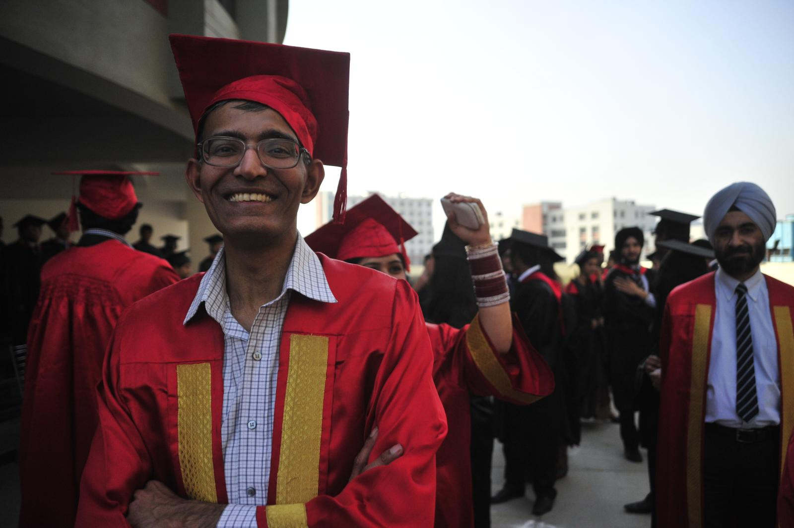 Prof Krishna and other faculty at graduation procession