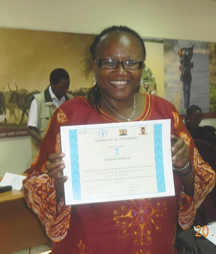 Elizabeth Waithanji, ILRI scientist with the Poverty Gender and Impact team showing off her training certificate after the workshop