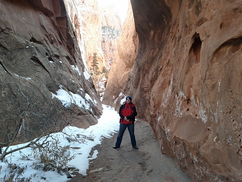 Me standing in a narrow canyon, right under an arch