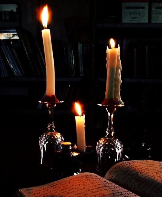 candles on a dark rainy day