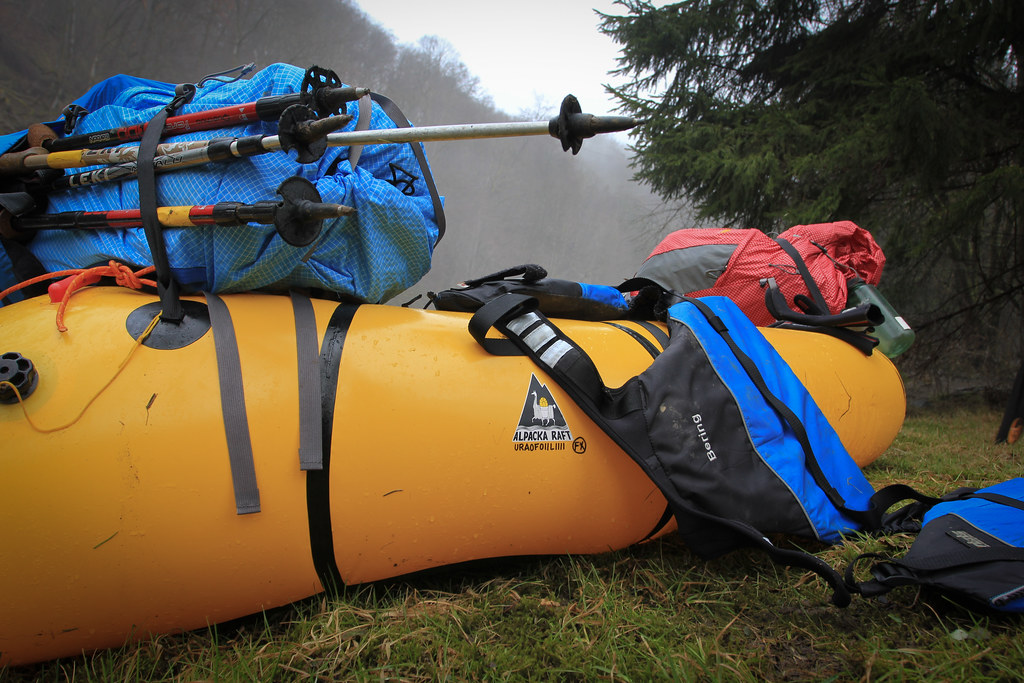 GoLite Pinnacles strapped on the Packraft
