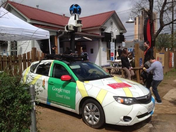Google Streetview car in the Google Village