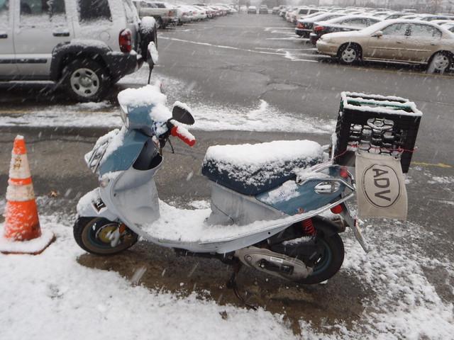 Snow covered Buddy scooter, Franz Biberkopf