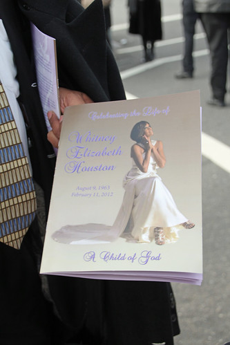 Whitney Houston funeral guest showing program to journalists