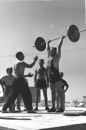 Weightlifting at the Maccabiah Village, from Government Press Office (GPO), under Creative Commons license