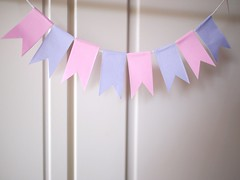 Baby pink and purple cake bunting, made from cheap origami paper