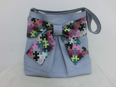 Pretty bow bag in coral grey