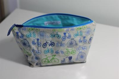 Plastic covered make up pouch