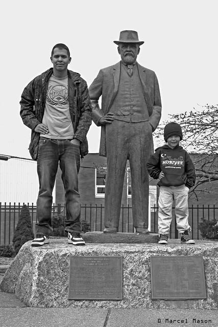 3 men on a rock