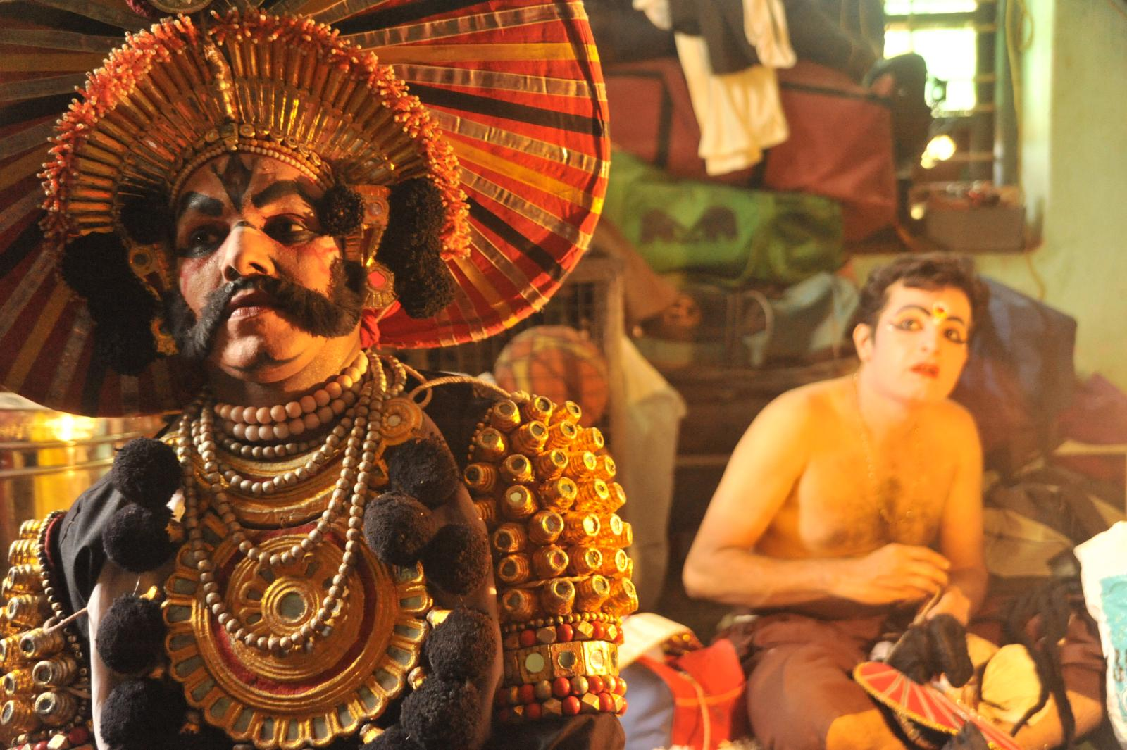Devoid of costume, Draupadi behind Kichaka. Yakshagana, Kichaka Vadha
