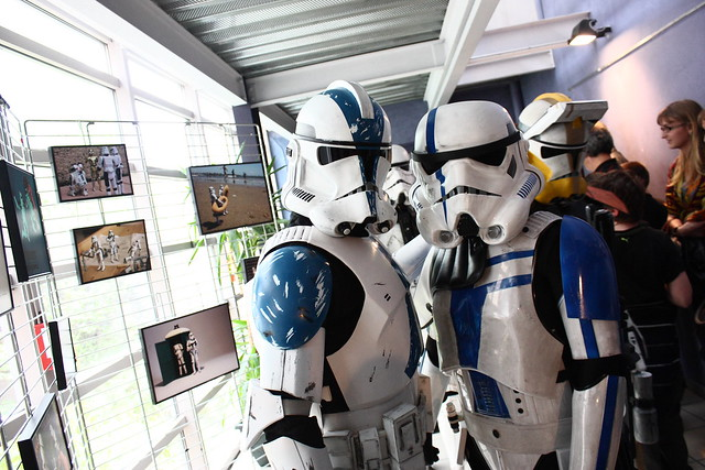 A photo of troopers in front of photos of troopers
