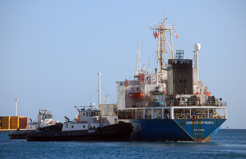 Tugs and Shin Co-Op Maru leaving