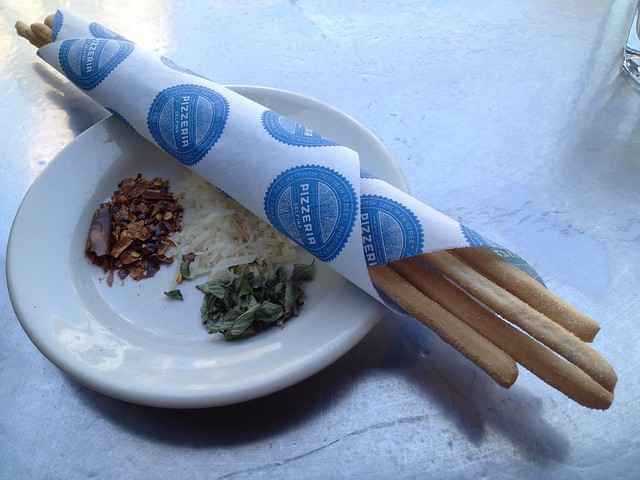 Breadsticks and pizza toppings - Pizzeria Delfina