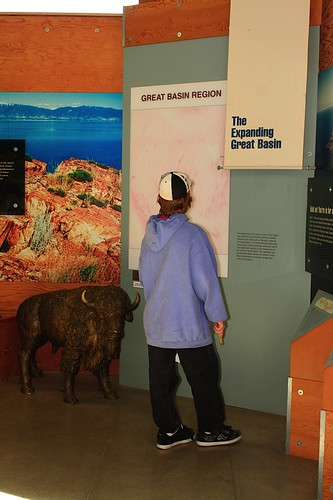 Ben studies the map of the Great Basin Region in the Visitors Center at Antelope Island State Park.
