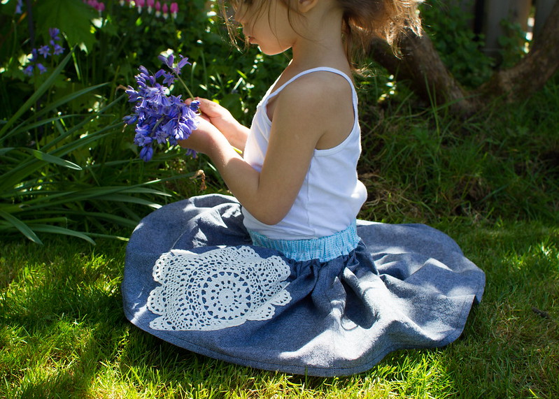 picking flowers in her doily skirt