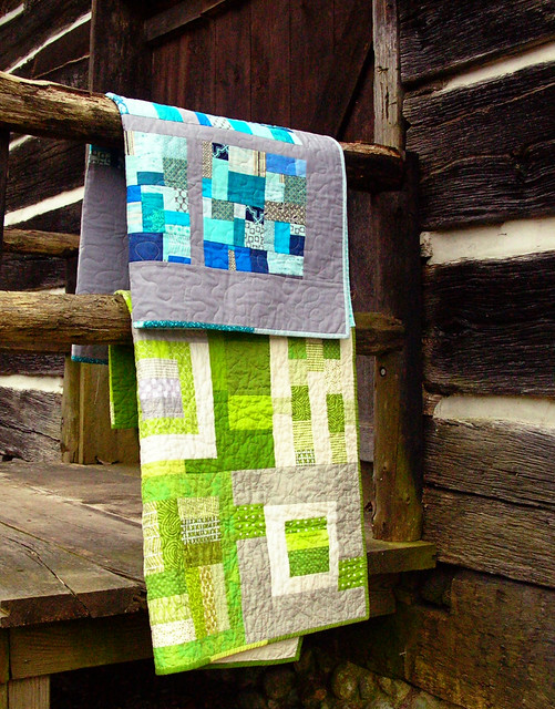 baby quilts on the porch rail