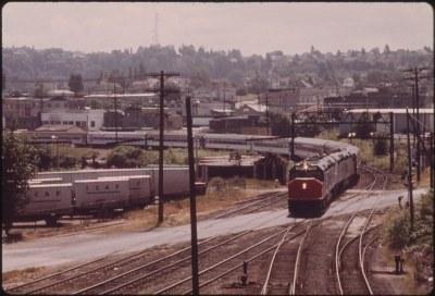The Coast Starlight (train #11) pulls into the Tacoma Washington passenger train depot, July 1974
