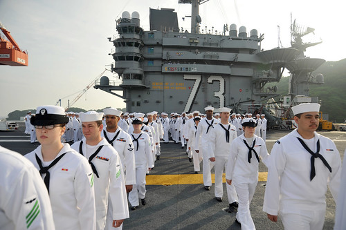 Sailors march toward the rails. by Official U.S. Navy Imagery