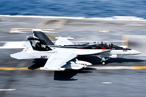 A jet is stopped by an arresting gear wire after landing aboard USS George Washington. by Official U.S. Navy Imagery