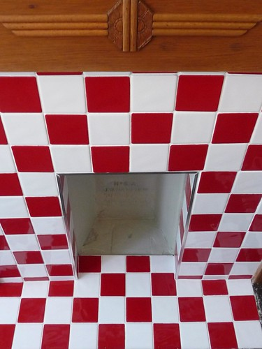 Red and white tiled fireplace