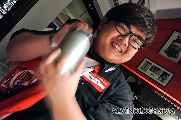 Yong Wei shaking his drink like an amateur at first