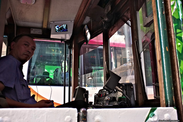 Tram Driver in a cockpit stuck in the traffic due to the protest