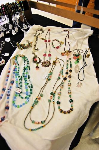 Beautiful necklaces on white crushed velvet