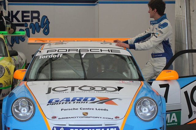 Porsche Carrera Cup driver  Sam Tordoff in his garage at BTCC in Donington Park in April 2012
