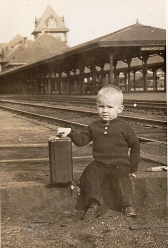 A young boy outside Manchester's Union Station in 1942. About twenty years later, it was torn down in favor of widened roads and car traffic. - Photo by George Lane.